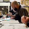 BEN MIKESELL | THE GOSHEN NEWS<br /> Instructor Mike Morehouse of Niles works on his pet portrait Thursday at Home Again Consignment as part of Pet Portrait Day.