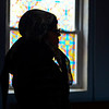 BEN MIKESELL | THE GOSHEN NEWS<br /> Galina Ostrovsky, Elkhart, attends the Good Friday service at Holy Virgin Protection Orthodox Church in Goshen.