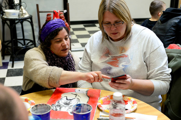 BEN MIKESELL | THE GOSHEN NEWS<br /> Instructor Michele Miller of Goshen gives advice to Angie Edwards as she paints a picture of her English bulldog Bob Thursday at Home Again Consignment in Goshen.