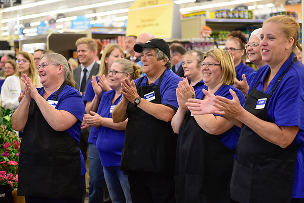 BEN MIKESELL | THE GOSHEN NEWS<br /> Kroger employees stand at the entrance welcoming customers into the newly renovated store Wednesday morning during the grand reopening in Goshen.