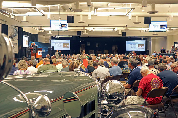GEOFF LESAR | THE GOSHEN NEWS<br /> <br /> Attendees of Saturday's auction at the former Hostetler's Hudson Auto Museum in Shipshewana gather for bidding.