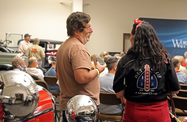 GEOFF LESAR   THE GOSHEN NEWS<br /> <br /> Charlie Woodruff, left, of Seoul, South Korea, and Lorrie Pontius, of Auburn, chat Saturday during the auction at the former Hostetler's Hudson Auto Museum in Shipshewana.