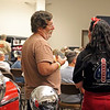 GEOFF LESAR | THE GOSHEN NEWS<br /> <br /> Charlie Woodruff, left, of Seoul, South Korea, and Lorrie Pontius, of Auburn, chat Saturday during the auction at the former Hostetler's Hudson Auto Museum in Shipshewana.