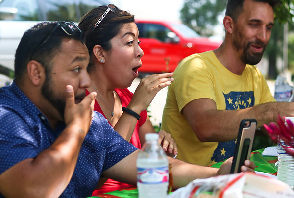 LEANDRA BEABOUT | THE GOSHEN NEWS<br /> Juan Constantino, of La Casa de Amistad in South Bend, Yolo López Pérez of Center for Healing and Hope in Goshen and Goshen Mayor Jeremy Stusman react to a spicy salsa during Saturday's Salsa Festival in Goshen.