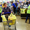 "BEN MIKESELL | THE GOSHEN NEWS<br /> Goshen resident Renee Nusbaum checks out during the grand reopening of the Kroger store Wednesday morning in Goshen. ""I'm thrilled to pieces,"" Nusbaum said. ""I've been waiting so long."""