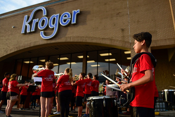 BEN MIKESELL | THE GOSHEN NEWS<br /> Members of the Goshen High School marching band perform the national anthem Wednesday morning before the reopening of the Kroger in Goshen.