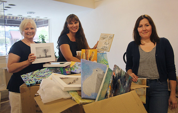 JOHN KLINE | THE GOSHEN NEWS<br /> Event coordinators, from left, Kathy Stiffney, Amy Worsham and Joni Earl pose with samples of artwork that will be featured at the first-ever Art for Everyone Gala set for Sept. 15.