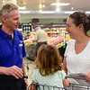 BEN MIKESELL | THE GOSHEN NEWS<br /> Jeff Cors, produce department leader at Kroger, talks with Goshen resident Kimberly Lichty-Nyce while shopping with her kids during the grand reopening of Kroger Wednesday morning in Goshen.