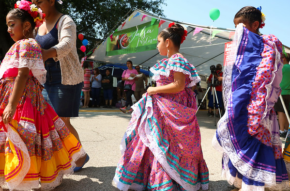 LEANDRA BEABOUT | THE GOSHEN NEWS<br /> Members of Las Guadalupanas, a folkloric dance group, walk toward thier starting positions for a performance at the third annual Salsa Festival hosted by the Goshen Farmers Market.