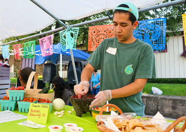 LEANDRA BEABOUT | THE GOSHEN NEWS<br /> Jose Chiquito mixes up a batch of salsa at the third annual Salsa Festival hosted by the Goshen Farmers Market.