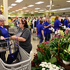 "BEN MIKESELL | THE GOSHEN NEWS<br /> Annette Gonzales, right, talks with Kroger employee Donna Newman, who is assisting from the store in Rochester, during the grand reopening Wednesday morning in Goshen. ""It looks very nice, and I've been waiting for them to open back up,"" Gonzalez said."