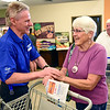BEN MIKESELL | THE GOSHEN NEWS<br /> Jeff Cors, produce department leader at Kroger, welcomes Goshen resident Miriam Stauffer into the Kroger store Wednesday morning, the first time since it flooded in February.
