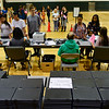 BEN MIKESELL | THE GOSHEN NEWS<br /> Concord eighth-grade students wait in line with parents to receive their Chromebooks Tuesday afternoon at Concord Junior High School.