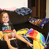 TERRAH HARMON | THE GOSHEN NEWS<br /> Anna Yutzy, 10, smiles from her seat on the couch Wednesday. It was her first day back home from Riley  Hospital for Children  in nearly a month.
