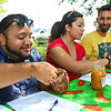LEANDRA BEABOUT | THE GOSHEN NEWS<br /> On the left, Juan Constantino, South Bend, prepares to rank a jar of salsa submitted for the competition at Goshen's third annual Salsa Festival. Yolo Lopez Perez, center, and Jeremy Stutsman, right, also judged.