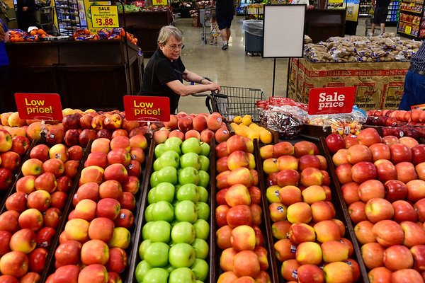 BEN MIKESELL | THE GOSHEN NEWS<br /> Betty Litwiller, of Goshen, peruses through the produce aisles during the grand reopening of the Kroger store Wednesday morning in Goshen.