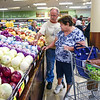 "BEN MIKESELL | THE GOSHEN NEWS<br /> Dennis and Barbara Corpe, of Goshen, peruse through the produce aisles Wednesday morning in the newly renovated Kroger during its grand reopening in Goshen. The Corpes were one of the store's earliest visitors eager to start shopping at the Goshen location since it flooded in February. ""This is our store,"" Dennis Corpe said."