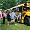 LEANDRA BEABOUT | THE GOSHEN NEWS<br /> Fairfield alumni line up to board a school bus headed to Fairfield Jr.-Sr. High School for a tour.