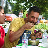 LEANDRA BEABOUT | THE GOSHEN NEWS<br /> Goshen Mayor Jeremy Stutsman samples a salsa during Saturday's competition at the Salsa Festival at the Goshen Farmers Market.