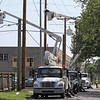LIZ RIETH | THE GOSHEN NEWS  Robert Henry Corp. workers set up utility poles off of Ninth Street and Reynolds Street for NIPSCO Thursday.