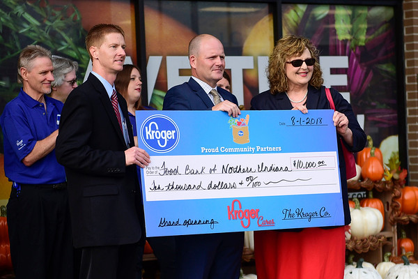 BEN MIKESELL | THE GOSHEN NEWS<br /> The Food Bank of Northern Indiana received $10,000 during the grand reopening of the Kroger store Wednesday morning in Goshen.