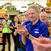 BEN MIKESELL | THE GOSHEN NEWS<br /> Jeff Cors, produce department leader at Kroger, welcomes customers into the Kroger store Wednesday morning, the first time since it flooded in February.