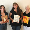 JOHN KLINE | THE GOSHEN NEWS<br /> Event coordinators, from left, Joni Earl, Amy Worsham and Kathy Stiffney pose with samples of artwork that will be featured at the first-ever Art for Everyone Gala set for Sept. 15.