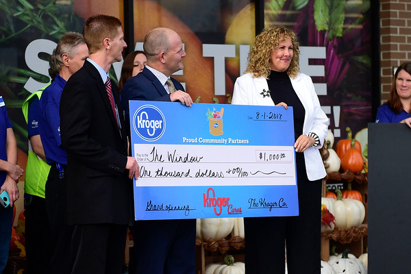 BEN MIKESELL | THE GOSHEN NEWS<br /> The Window received $1,000 during the grand reopening of the Kroger store Wednesday morning in Goshen.