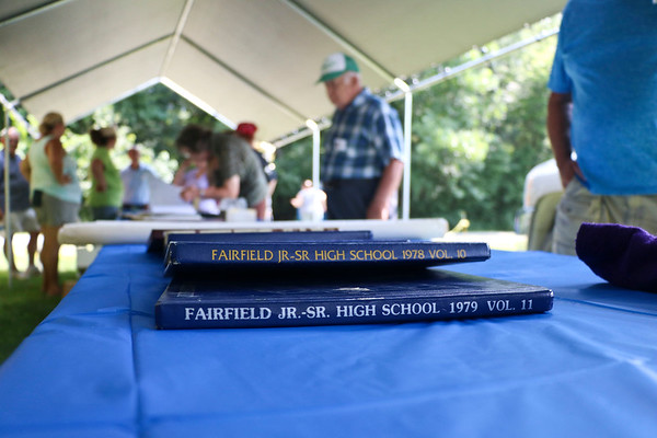 LEANDRA BEABOUT | THE GOSHEN NEWS<br /> Fairfield alumni page through school yearbooks and programs as they sign in at the 50th anniversary for Fairfield Community Schools.