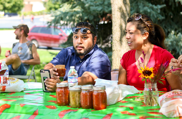 LEANDRA BEABOUT | THE GOSHEN NEWS<br /> Juan Constantino, the development coordinator at La Casa de Amistad in South Bend, reacts to an especially spicy salsa as he judges the salsa competition at the third annual Salsa Festival in Goshen.