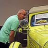 GEOFF LESAR | THE GOSHEN NEWS<br /> <br /> Bill Vaillancourt, of Goshen, peers inside a Hudson during the Saturday's auction at the former Hostetler's Hudson Auto Museum in Shipshewana.