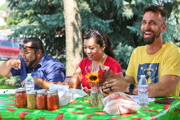 "LEANDRA BEABOUT | THE GOSHEN NEWS<br /> Juan Constantino, South Bend, Yolo López Pérez, Goshen, and Goshen Mayor Jeremy Stusman judge the salsa competition at Goshen's third annual Salsa Festival. Here they react to a salsa in the ""hot"" category."