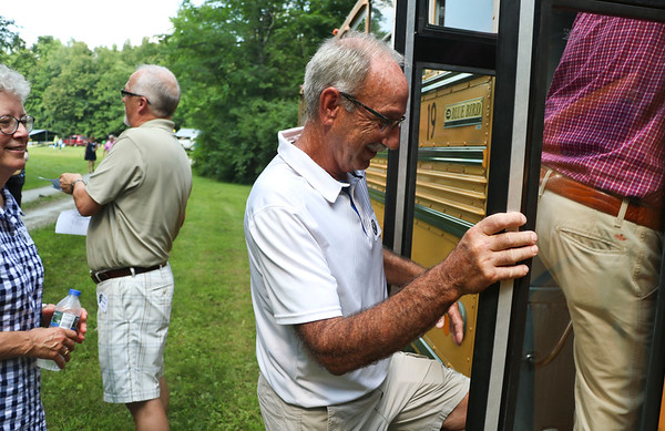 LEANDRA BEABOUT   THE GOSHEN NEWS<br /> Lyle Garber, a '71 graduate of Fairfield High School and current bus driver for the corporation, boards a school bus during the 50th anniversary for Fairfield Community Schools.