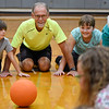 BEN MIKESELL | THE GOSHEN NEWS<br /> Physical education teacher Michael Grieser plays a team-building game with students for the first day of school Wednesday morning at Westview Elementary School.