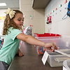 "LEANDRA BEABOUT | THE GOSHEN NEWS<br /> Adalynn Lindsey, 5, puts her supplies away in her kindergarten classroom at Syracuse Elementary School during ""Back to School"" night Tuesday."