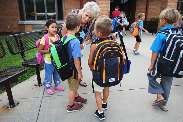 JULIE CROTHERS BEER | THE GOSHEN NEWS<br /> Kindergarten teacher Melanie Williams greets students on their first day of school Wednesday at Woodview Elementary School in Nappanee.