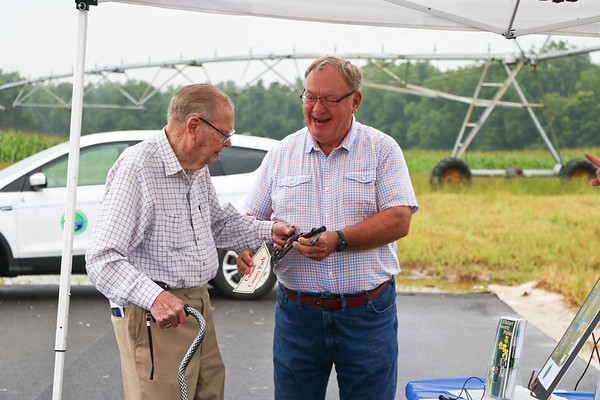 LEANDRA BEABOUT | THE GOSHEN NEWS<br /> Larry Andrews, right, a board member of the Elkhart County Parks, presents Tom Corson with a key to the parks.