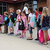 JULIE CROTHERS BEER | THE GOSHEN NEWS<br /> Kindergarten students in Brandy Hahn's class wait in a line Wednesday on the first day of school at Woodview Elementary School in Nappanee.