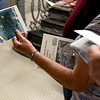 BEN MIKESELL | THE GOSHEN NEWS<br /> Esther Yoder Alwine holds a dated photo of the tunnels rumored to run underneath the courthouse grounds during a tour Thursday morning at the Elkhart County Courthouse.