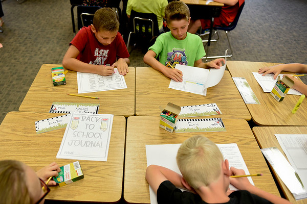 BEN MIKESELL   THE GOSHEN NEWS<br /> Third-grade students in Ashley Wetzel's class fill out their back-to-school journals Wednesday morning at Parkside Elementary School in LaGrange.