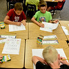 BEN MIKESELL | THE GOSHEN NEWS<br /> Third-grade students in Ashley Wetzel's class fill out their back-to-school journals Wednesday morning at Parkside Elementary School in LaGrange.