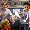 BEN MIKESELL | THE GOSHEN NEWS<br /> Sixth-grade students Tyler Fry, left, and Omar Saleh, right, attempt to catch tissues during a team building exercise in Jeremy Williams' class for the first day of school Wednesday morning at Westview Elementary School.
