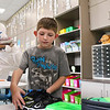 "LEANDRA BEABOUT | THE GOSHEN NEWS<br /> Ryder Eppert, 6, sorts his school supplies on ""Back to School"" night at Syracuse Elementary School."