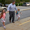 BEN MIKESELL | THE GOSHEN NEWS<br /> Kevin Doyle, Dunlap, walks with his two daughters, Kinsley, left, and Ashlyn, right, who are starting first grade and kindergarten respectively Wednesday morning at Concord East Side Elementary School.