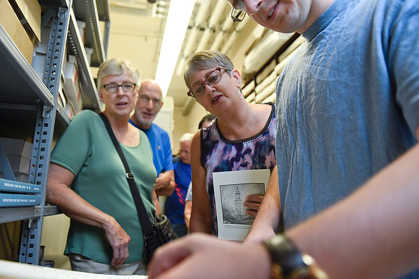 BEN MIKESELL | THE GOSHEN NEWS<br /> Lori Martin, Goshen, looks through a book of marriage license records with the help of her son Peter during a tour of the Elkhart County Courthouse Thursday morning in Goshen.