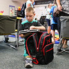 "LEANDRA BEABOUT | THE GOSHEN NEWS<br /> Xander Bowers, 7, unpacks his school supply at Tuesday's ""Back to School"" night at Syracuse Elementary School."