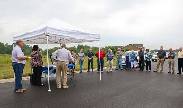LEANDRA BEABOUT | THE GOSHEN NEWS<br /> A small crowd gathered Friday morning in Middlebury to witness the dedication ceremony for the future Corson County Park.
