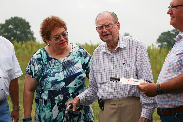 LEANDRA BEABOUT | THE GOSHEN NEWS<br /> Tom Corson, center, stands with his daughter, Claire Skinner, at the dedication ceremony for Corson County Park.