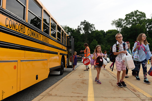 BEN MIKESELL   THE GOSHEN NEWS<br /> Students walk off the busses ready for the first day of school Wednesday morning at Concord East Side Elementary School.