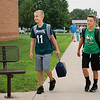 JULIE CROTHERS BEER | THE GOSHEN NEWS<br /> Woodview Elementary School students Micah Jarrell, fourth grade, and Caleb Vincent, fifth grade, walk toward the school after climbing off the bus on the first day of school Wednesday in Nappanee.